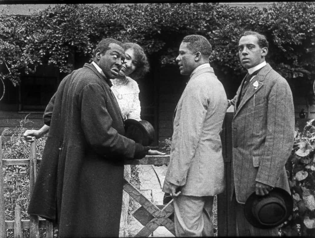 Scene still Bert Williams Lime Kiln Field Day Project. From left to right: Bert Williams, Odessa Warren Grey, unidentified, Walker Thompson